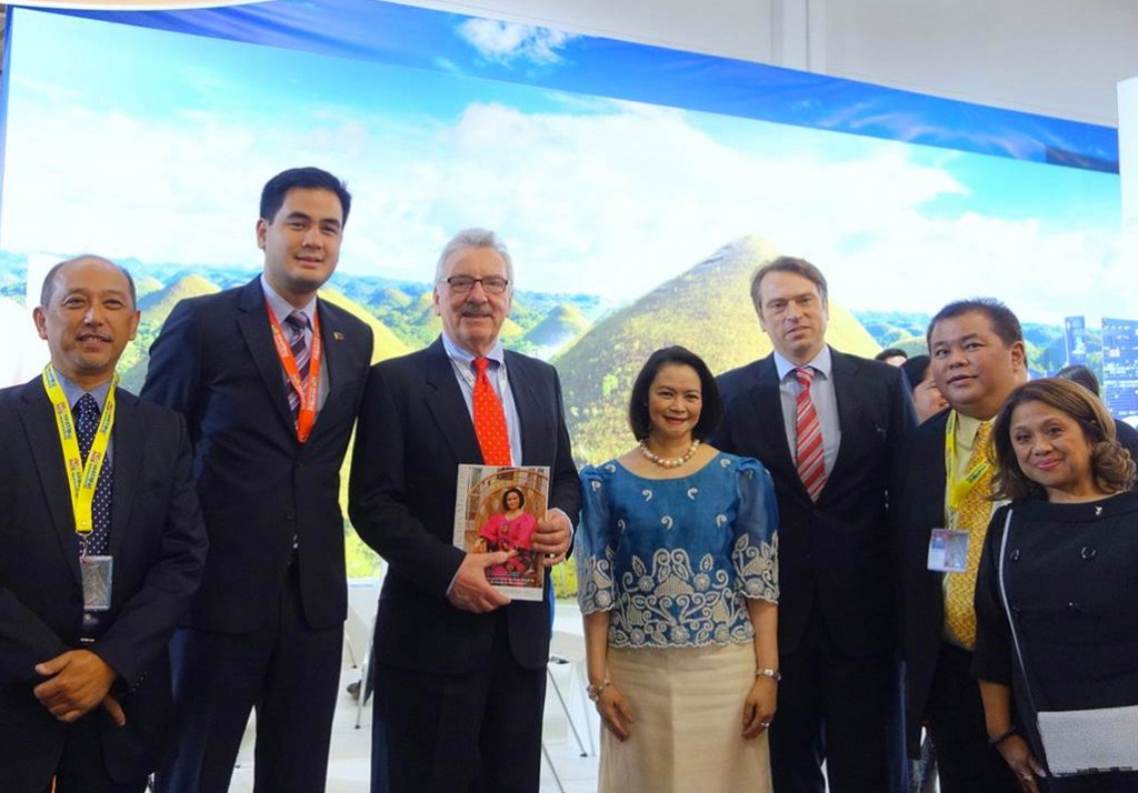 "Ambassador Natividad presents Bundestag MP Jürgen Klimke (third from left) with a copy of the Diplomatisches Magazin ""Philippines Country Special."" Also present from left are TPB CEO Mr. Domingo Ramon C. Enerio III, Hon. Rep. Dakila Carlo E. Cua, Mr. Thomas Ossowski, Hon. Rep. Rene L. Relampagos, and DOT Regional Director Venus Tan."