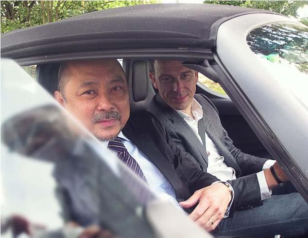 "PTIC Commercial Counselor Buencamino (left) rides the electric-powered car driven by Mp-tec CEO Michael Preißel. The car was ""refueled"" by Mp-tec's high-quality solar carport."