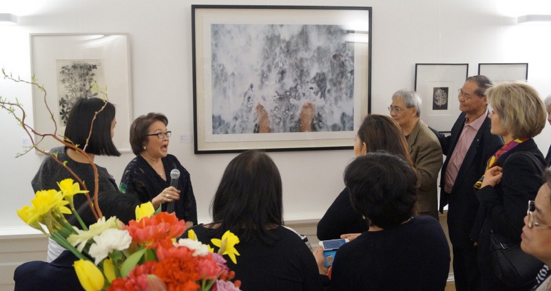 The artist explaining her work to guests during the exhibit walk through