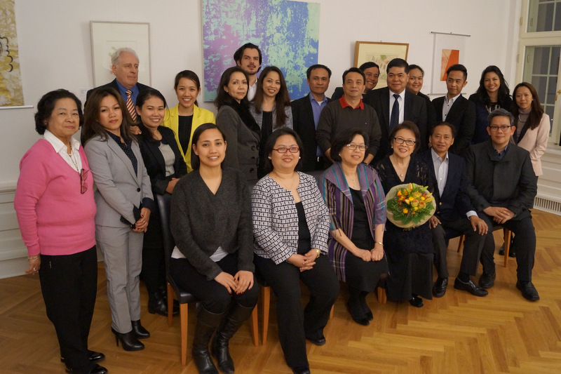 The artist and her family with Embassy officials and staff