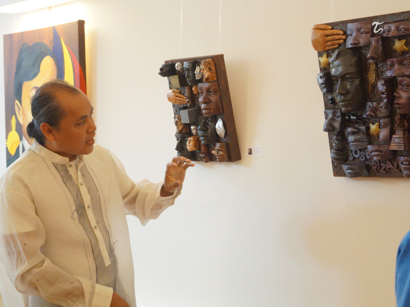 Garcia explains his relief sculptures of Rizal.