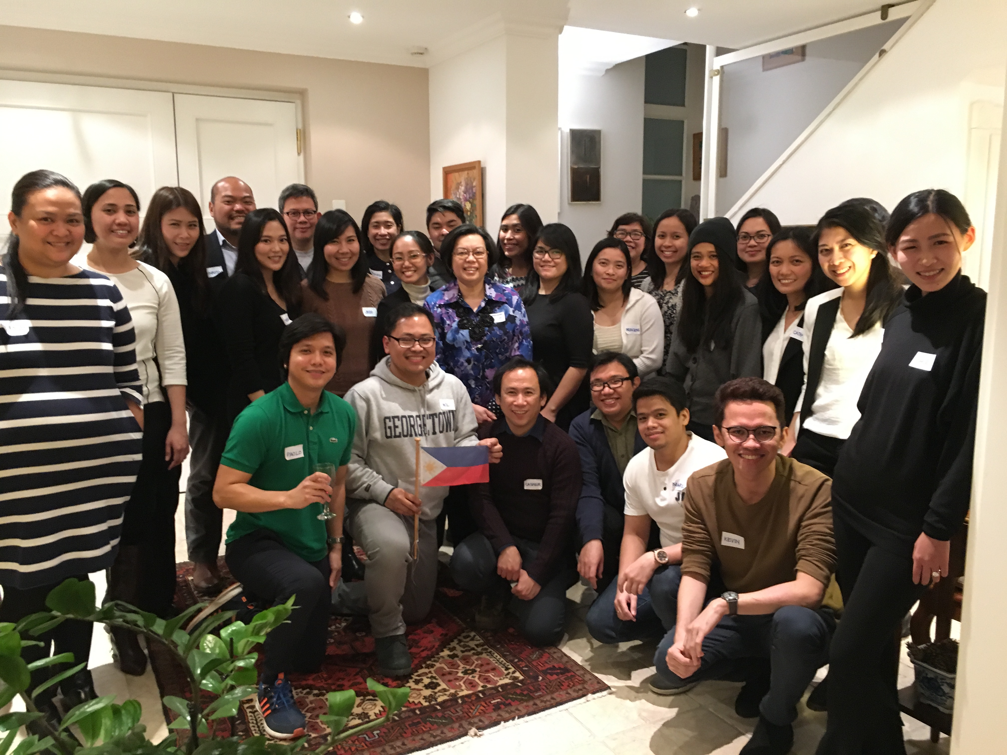 Souvenir photo pose: the graduate students and young professionals gathered at the Residence to unwind on a Saturday evening.