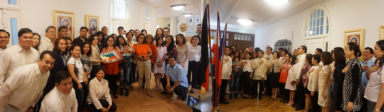 (Left photo) Embassy personnel and consular clients posing for photo with the Independence Day cake. (Right photo) Embassy personnel and consular clients singing the Philippine National Anthem at the chancery on June 13.