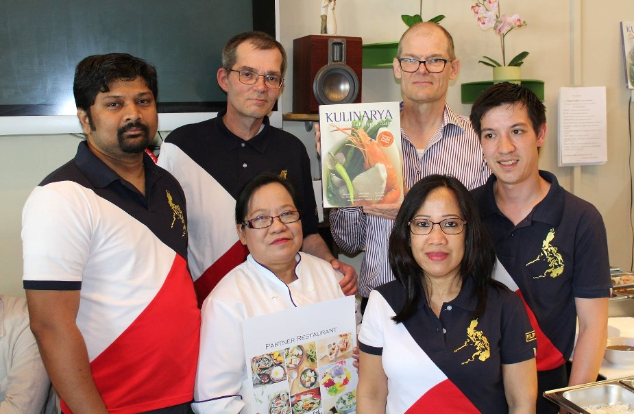 Lucky customer of Lynn Cuisine wins Kulinarya cook book.