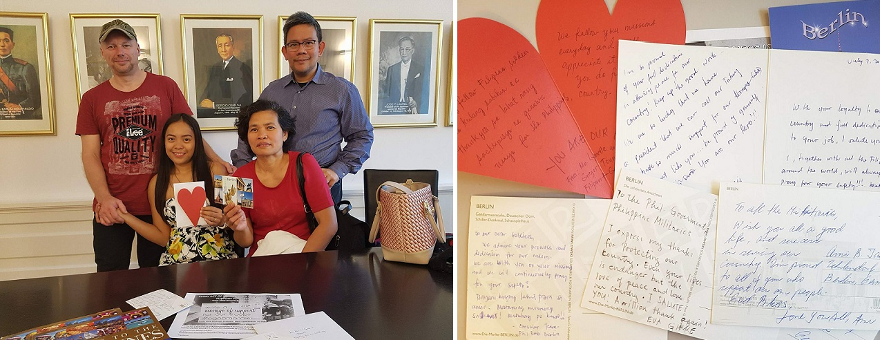 Photo, Left: Consul Adrian Cruz (standing, right) poses with Mrs. Eva Girke (seated right) and Mr. and Mrs. Gregor and Maria Lynette Toennies holding cards bearing messages of support for our Filipino troops. Right Photo: Outpouring of support from appreciative Filipinos in Germany.