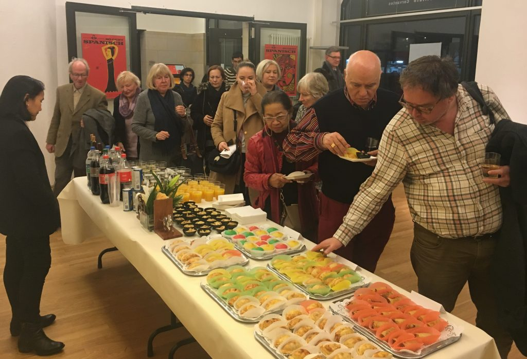 Guests enjoying Filipino empanada, steamed rice cakes, and banana fritters, Philippine mango juice, and Spanish wine after the concert.